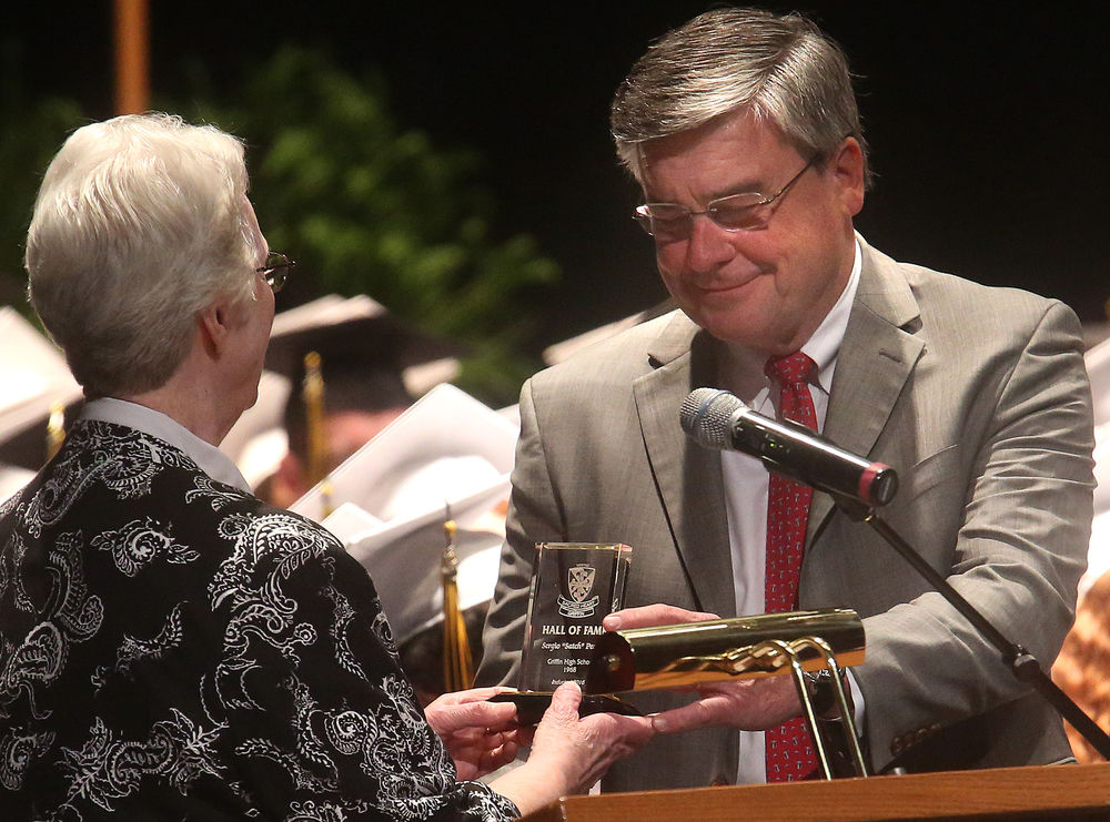 "Sergio ""Satch"" Pecori, a graduate of Griffin High School class of 1968, was inducted into the SHG Hall of Fame by Sister Katherine O'Connor on Sunday. David Spencer/The State Journal-Register"