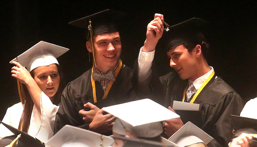 Officially graduated, students moved their mortarboard tassles to complete the moment Sunday. David Spencer/The State Journal-Register