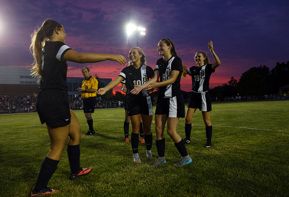 Sacred Heart-Griffin's Katie Beyer is happily greeted by her teammates after scoring in the penalty kicks against Alton Marquette's  during the Class 1A supersectional at UIS Tuesday, May 24, 2016. The joy was short lived as the Cyclones lost. Ted Schurter/The State Journal-Register