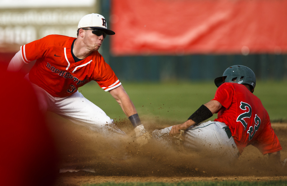 Lincoln's Aron Hopp (23) beats the tag from Rochester's Christian Lett (3) for a stolen base in the 1st inning during the Class 3A Springfield Regional Semifinals at Robin Roberts Stadium, Wednesday, May 25, 2016, in Springfield, Ill. Justin L. Fowler/The State Journal-Register