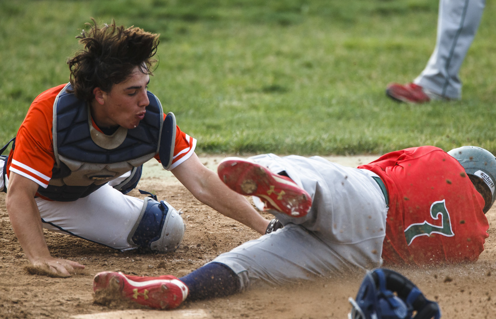 Lincoln's Andrew Yount (7) beats the tag at home from Rochester's Nic Baker (4) to score a run in the 3rd inning during the Class 3A Springfield Regional Semifinals at Robin Roberts Stadium, Wednesday, May 25, 2016, in Springfield, Ill. Justin L. Fowler/The State Journal-Register