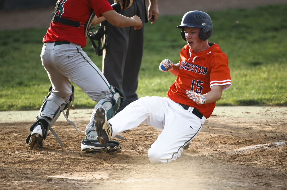 Rochester's Adam Bunch (15) slides safely into home to put the Rockets on the board at 3-1 against Lincoln in the 3rd inning during the Class 3A Springfield Regional Semifinals at Robin Roberts Stadium, Wednesday, May 25, 2016, in Springfield, Ill. Justin L. Fowler/The State Journal-Register