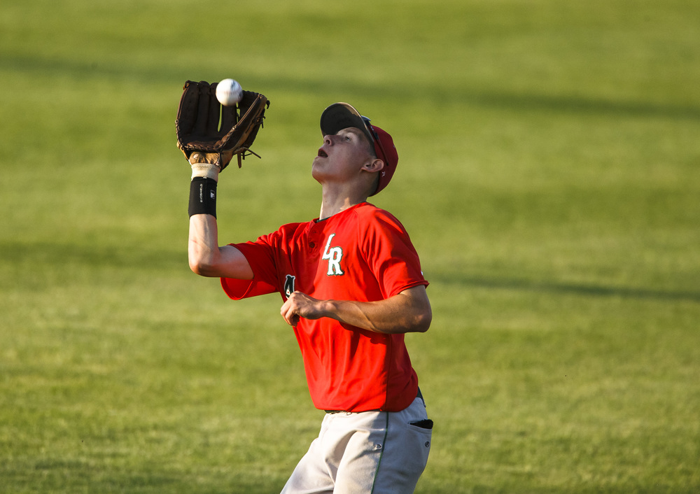 Lincoln's Colton Holliday (4) catches a fly ball from Rochester in the 4th inning during the Class 3A Springfield Regional Semifinals at Robin Roberts Stadium, Wednesday, May 25, 2016, in Springfield, Ill. Justin L. Fowler/The State Journal-Register