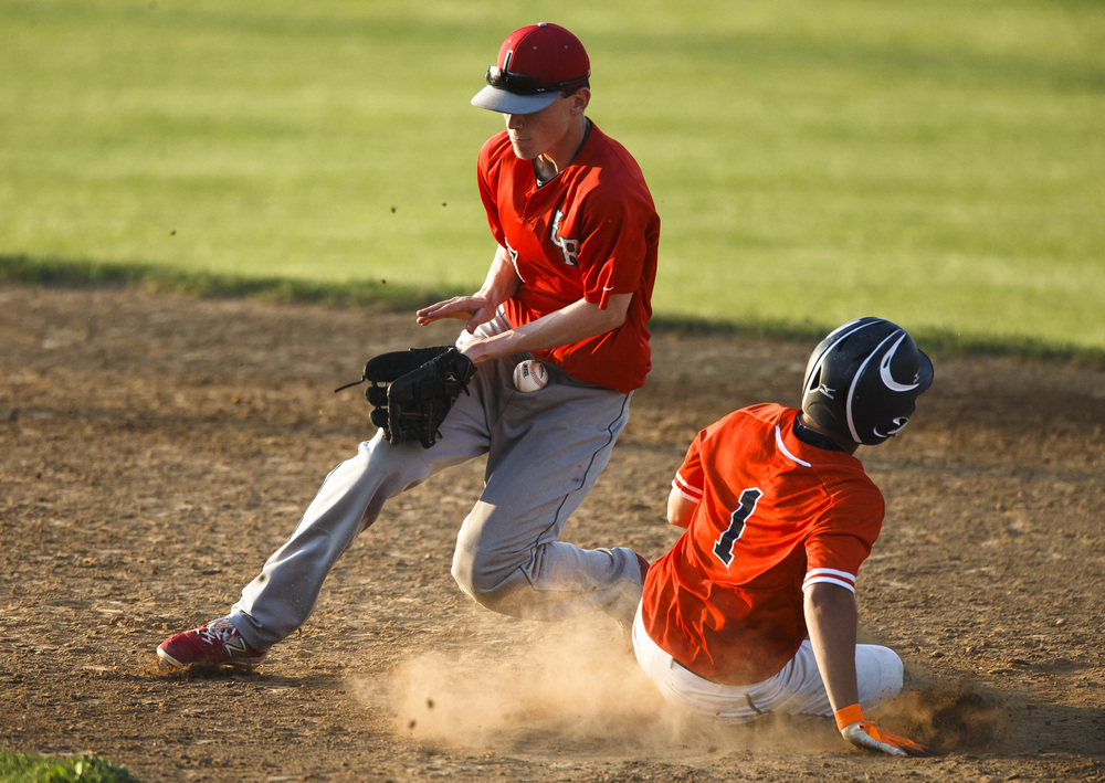 Rochester's Ben Chapman (1) steals second base against Lincoln's Andrew Yount (7) in the 4th inning during the Class 3A Springfield Regional Semifinals at Robin Roberts Stadium, Wednesday, May 25, 2016, in Springfield, Ill. Justin L. Fowler/The State Journal-Register