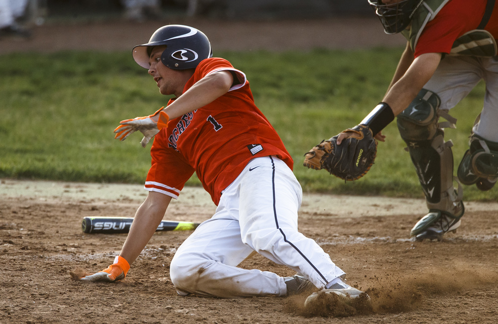 Rochester's Ben Chapman (1) avoids the tag from Lincoln's Jake Konczyk (8) at home plate to make it 4-3 Railsplitters during the Class 3A Springfield Regional Semifinals at Robin Roberts Stadium, Wednesday, May 25, 2016, in Springfield, Ill. Justin L. Fowler/The State Journal-Register