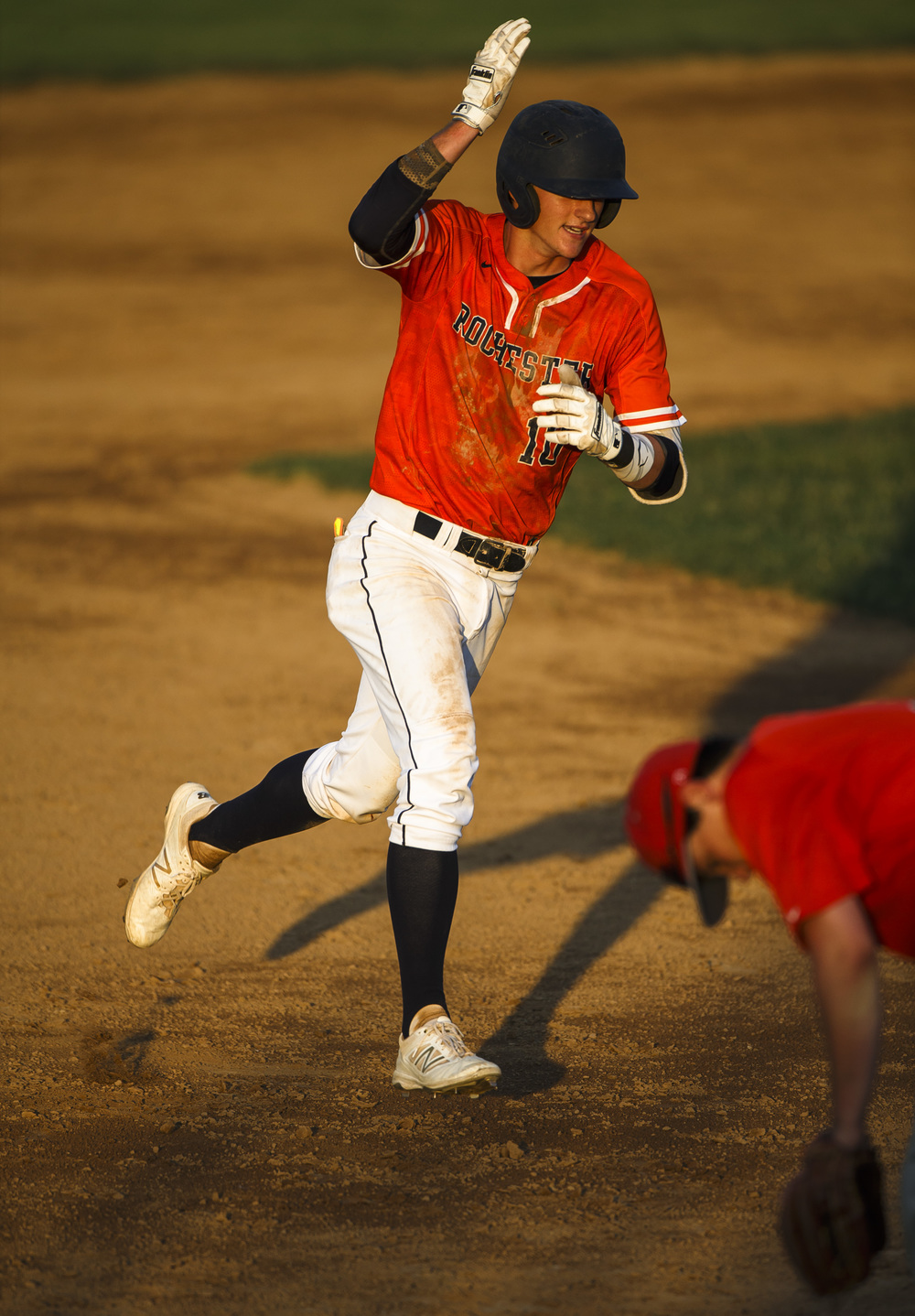 Rochester's Tyler Fitzgerald (10) signals towards the dugout as he rounds third after hitting a home run to tie the game against Lincoln in the 5th inning during the Class 3A Springfield Regional Semifinals at Robin Roberts Stadium, Wednesday, May 25, 2016, in Springfield, Ill. Justin L. Fowler/The State Journal-Register