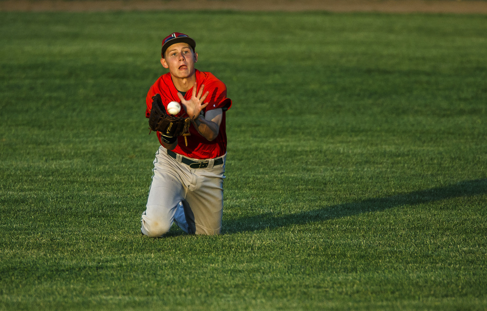 Lincoln's Colton Holliday (4) makes a diving catch in the outfield against Rochester in the 5th inning during the Class 3A Springfield Regional Semifinals at Robin Roberts Stadium, Wednesday, May 25, 2016, in Springfield, Ill. Justin L. Fowler/The State Journal-Register