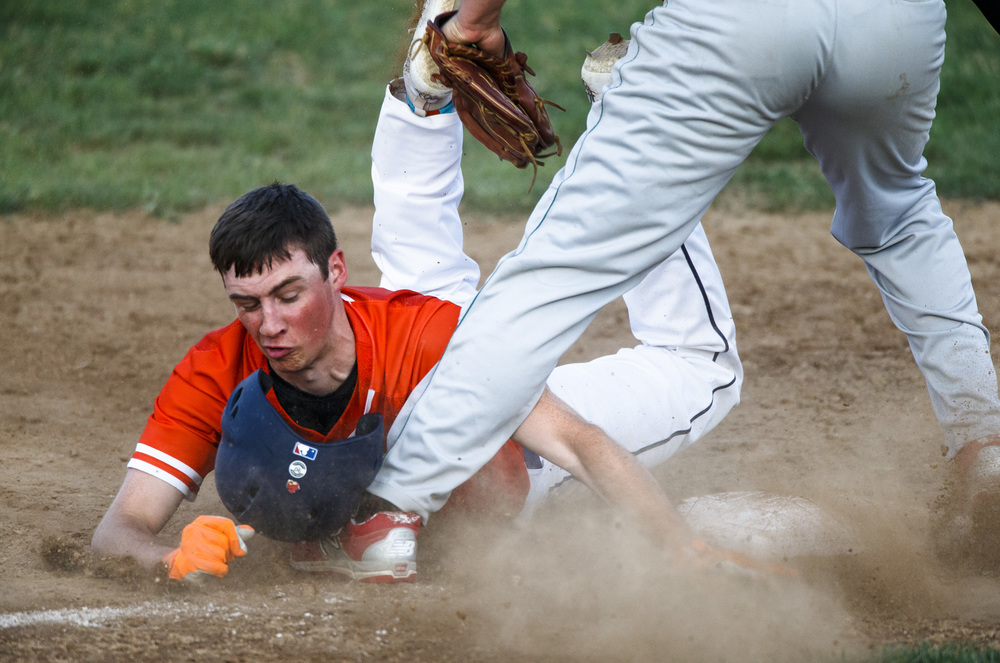 Rochester's Noah Skinner (2) beats the tag into third base against Lincoln's Cooper Hake (9) for a stolen base in the 5th inning during the Class 3A Springfield Regional Semifinals at Robin Roberts Stadium, Wednesday, May 25, 2016, in Springfield, Ill. Justin L. Fowler/The State Journal-Register