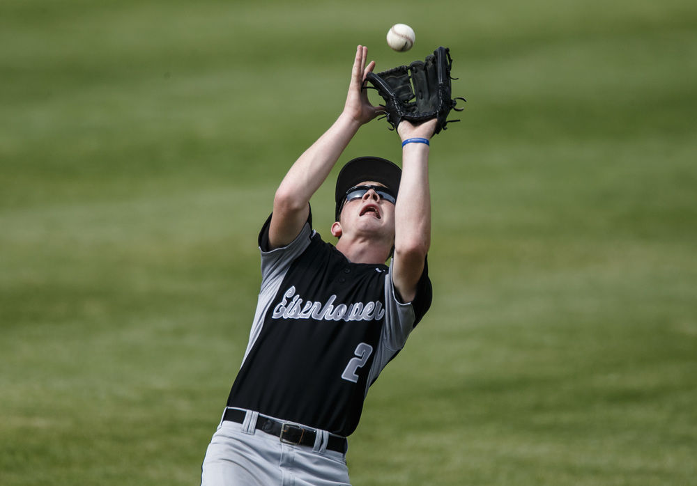 Decatur Eisenhower's Matt Skeffington (2) catches a fly ball from Springfield in the 1st inning during the Class 3A Springfield Regional Semifinals at Robin Roberts Stadium, Wednesday, May 25, 2016, in Springfield, Ill. Justin L. Fowler/The State Journal-Register