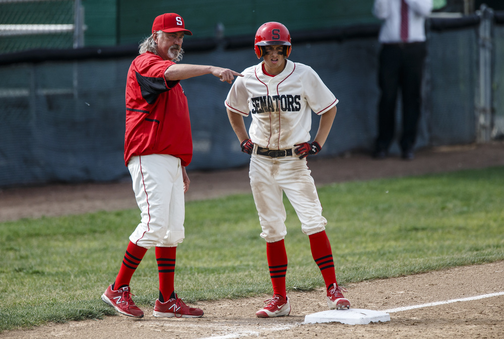 Springfield's Jake Langellier (10) talks with head coach Jim Steinwart at third base after a stolen base in the 1st inning as the Senators take on Decatur Eisenhower during the Class 3A Springfield Regional Semifinals at Robin Roberts Stadium, Wednesday, May 25, 2016, in Springfield, Ill. Justin L. Fowler/The State Journal-Register