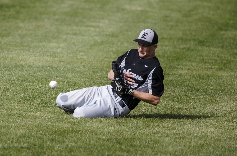 Decatur Eisenhower's Will Ashlock (3) has a fly ball pop off his glove as he tries to make a sliding catch against Springfield in the 2nd inning during the Class 3A Springfield Regional Semifinals at Robin Roberts Stadium, Wednesday, May 25, 2016, in Springfield, Ill. Justin L. Fowler/The State Journal-Register