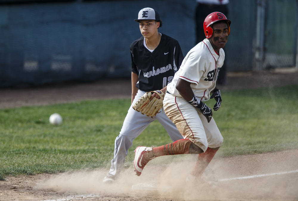 Springfield's Damian Pierce (12) keeps his eye on the ball after sliding into third for a triple before taking off for home to score a run on a Decatur Eisenhower error during the Class 3A Springfield Regional Semifinals at Robin Roberts Stadium, Wednesday, May 25, 2016, in Springfield, Ill. Justin L. Fowler/The State Journal-Register