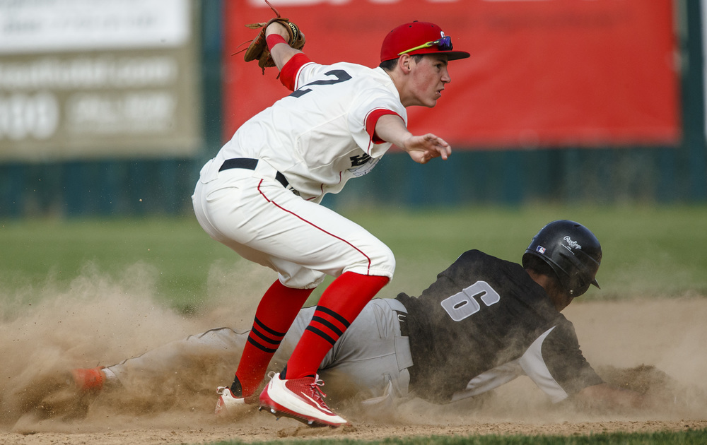Decatur Eisenhower's LaMontie Williams (6) beats the tag from Springfield's Trevor Minder (2) for a stolen base in the 3rd inning during the Class 3A Springfield Regional Semifinals at Robin Roberts Stadium, Wednesday, May 25, 2016, in Springfield, Ill. Justin L. Fowler/The State Journal-Register