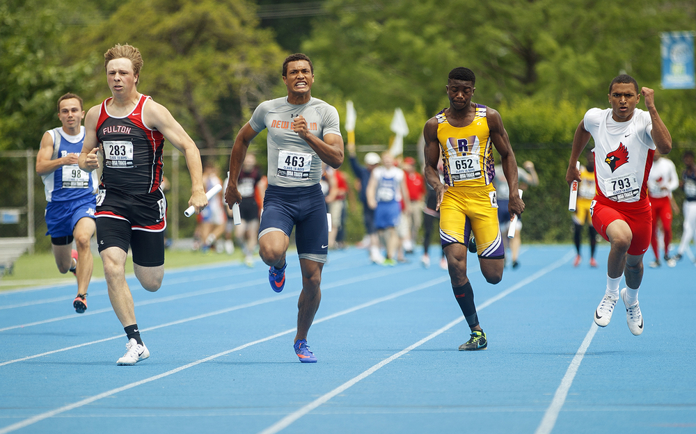 New Berlin's Kahlil Wassell pulls ahead for the win in the 4x100-meter relay during the IHSA Track and Field State Finals at O'Brien Stadium in Charleston, Ill., Saturday, May 28, 2016. Ted Schurter/The State Journal-Register