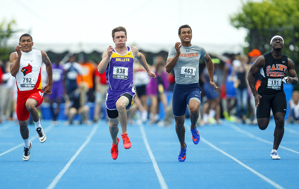 Williamsville's Connor Icenogle holds off New Berlin's Kahlil Wassell for the win in the 100-meter dash during the IHSA Track and Field State Finals at O'Brien Stadium in Charleston, Ill., Saturday, May 28, 2016. Ted Schurter/The State Journal-Register