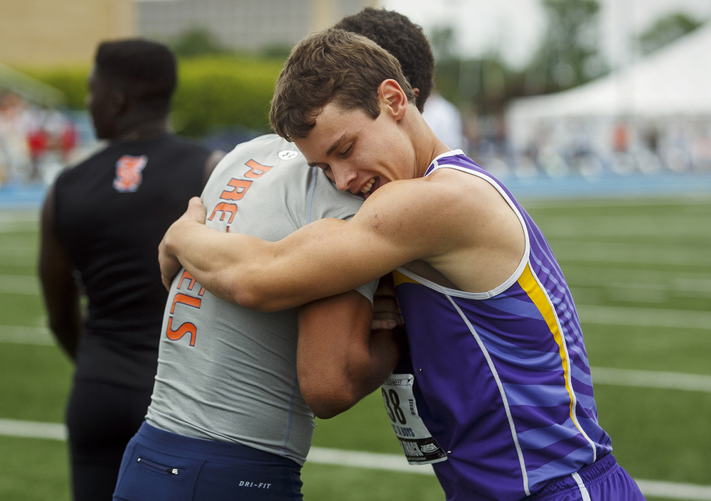 Williamsville's Connor Icenogle embraces New Berlin's Kahlil Wassell after edging him for the win in the 100-meter dash during the IHSA Track and Field State Finals at O'Brien Stadium in Charleston, Ill., Saturday, May 28, 2016. Ted Schurter/The State Journal-Register