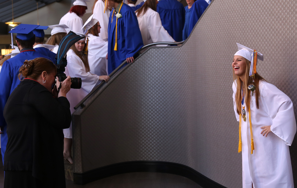 Salutatorian Alexis Brauer strikes a photogenic pose for her aunt Kim Schulte in the lobby of the hotel. David Spencer/The State Journal-Register