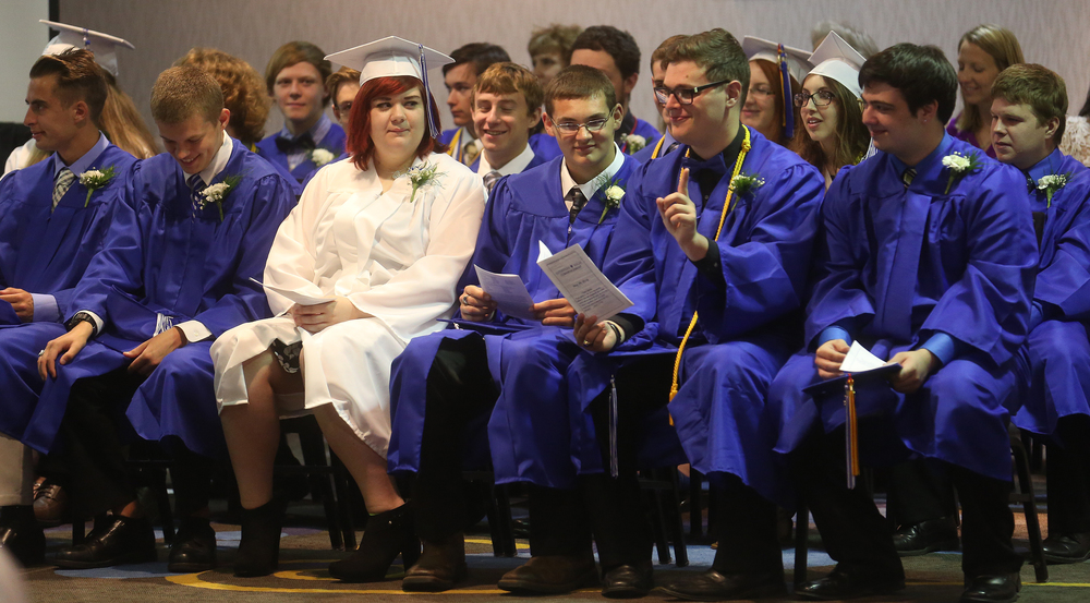 Raising a finger in acknowledgment of a memorable student moment called out during the Commencement was student Matt Henton. David Spencer/The State Journal-Register