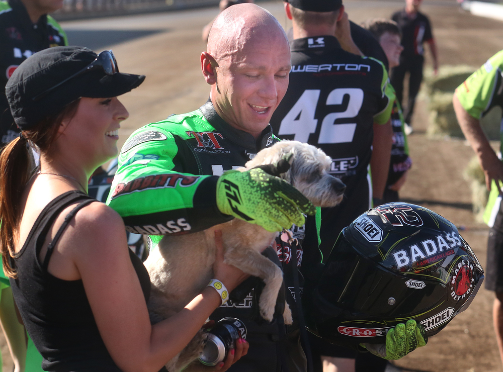 "Greeting winner Bryan Smith in the winners circle was girlfriend Christal Morse who hands off their dog ""Greedy"" to Smith. David Spencer/The State Journal-Register"