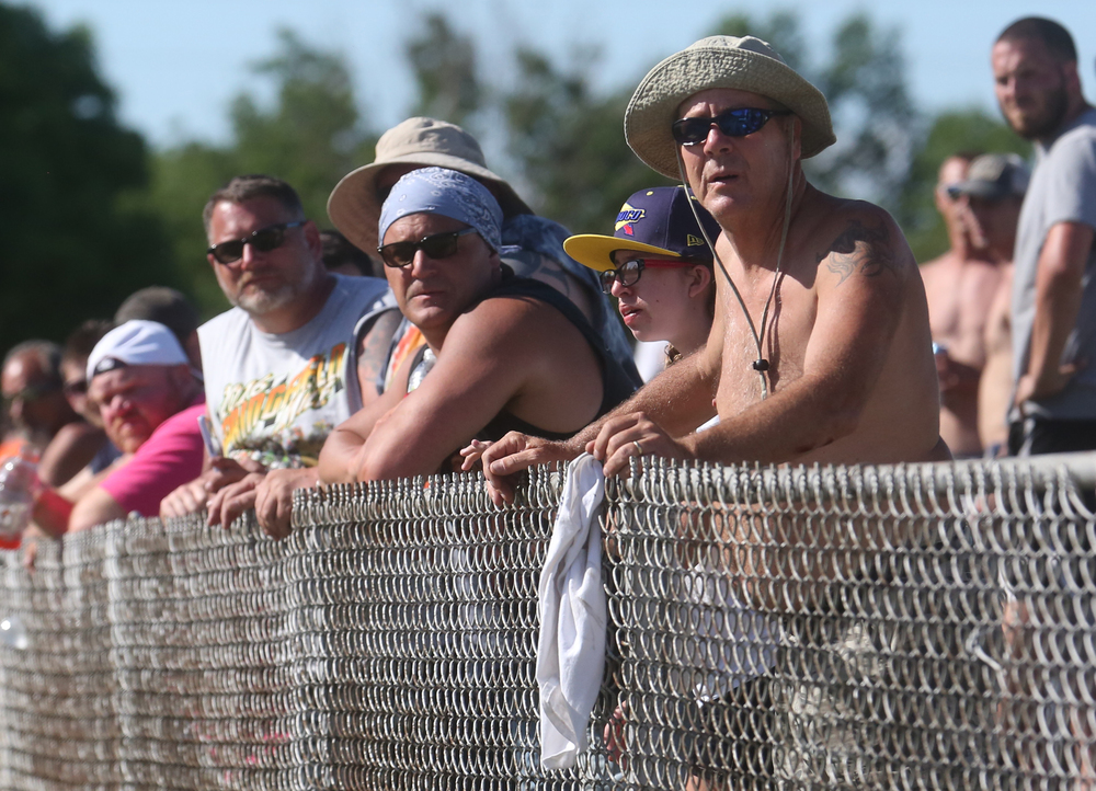 The weather was warm enough for no shirts for some spectators in the infield area during the race. David Spencer/The State Journal-Register