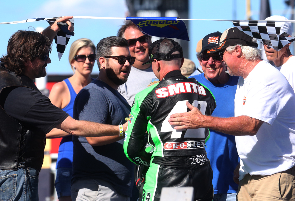 Winner Bryan Smith is greeted by race fans onstage before the presentation of trophies Sunday afternoon.  David Spencer/The State Journal-Register