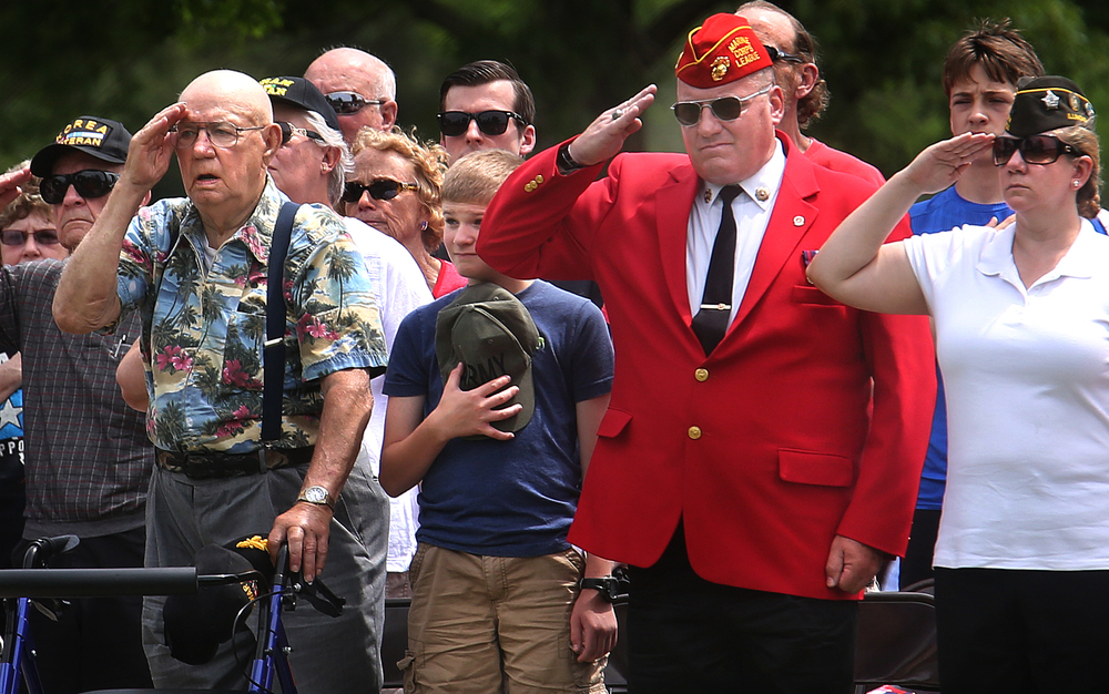 During the Pledge of Allegiance, veterans and others attending the ceremony saluted and placed hands over their hearts. David Spencer/The State Journal-Register