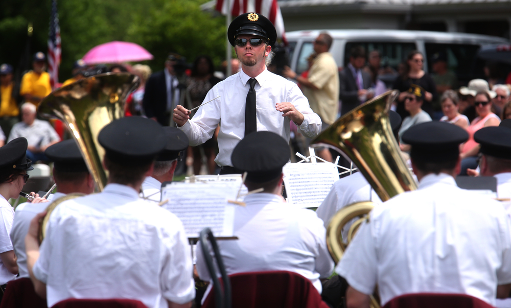 Tom Philbrick conducts the Springfield Municipal Band with patriotic selections Monday afternoon. David Spencer/The State Journal-Register