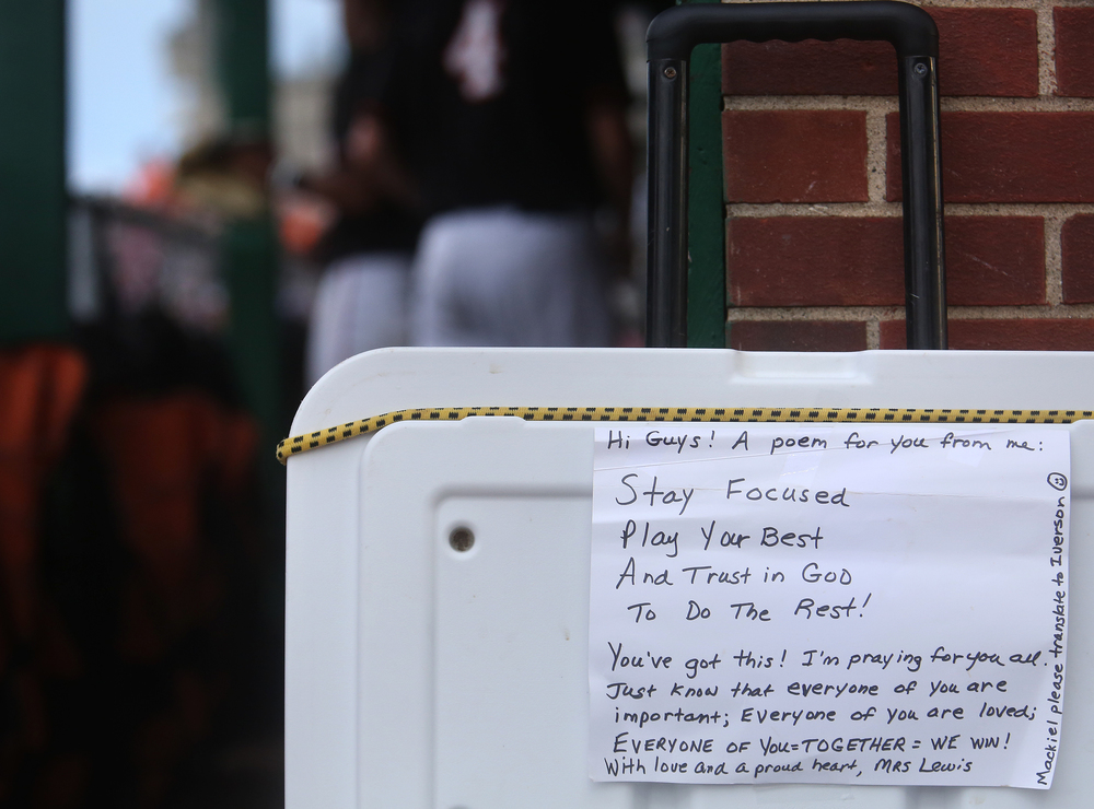Near the Tigers dugout, a poem taped to the lid of a beverage cooler by a Mrs. Lewis surely got the team smiling early in the game. David Spencer/The State Journal-Register