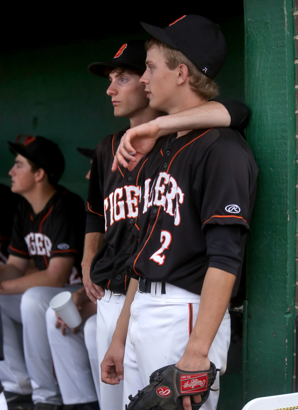Tiger teammates and pitchers Rick Dour in middle Supersectional pitcher Dalton Leischner at right strategized before the game in the dugout. David Spencer/The State Journal-Register