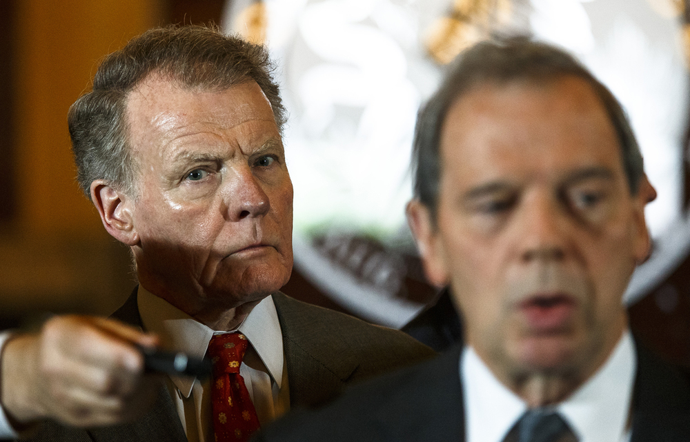 Illinois Speaker of the House Michael Madigan, D-Chicago, stands behind Illinois Senate President John Cullerton, D-Chicago, as they hold a press conference outside Illinois Gov. Bruce Rauner's office after a leaders meeting on the final day of the spring legislative session at the Illinois State Capitol, Tuesday, May 31, 2016, in Springfield, Ill. Justin L. Fowler/The State Journal-Register
