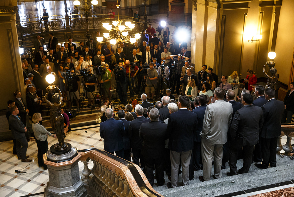 Illinois Gov. Bruce Rauner, center, along with Illinois Senate Minority Leader Christine Radogno, R-Lemont, and Illinois House Minority Leader Jim Durkin, R-Western Springs, joined by Senate and House Republicans hold a press conference on the second floor steps on the final day of the spring legislative session at the Illinois State Capitol, Tuesday, May 31, 2016, in Springfield, Ill. Justin L. Fowler/The State Journal-Register