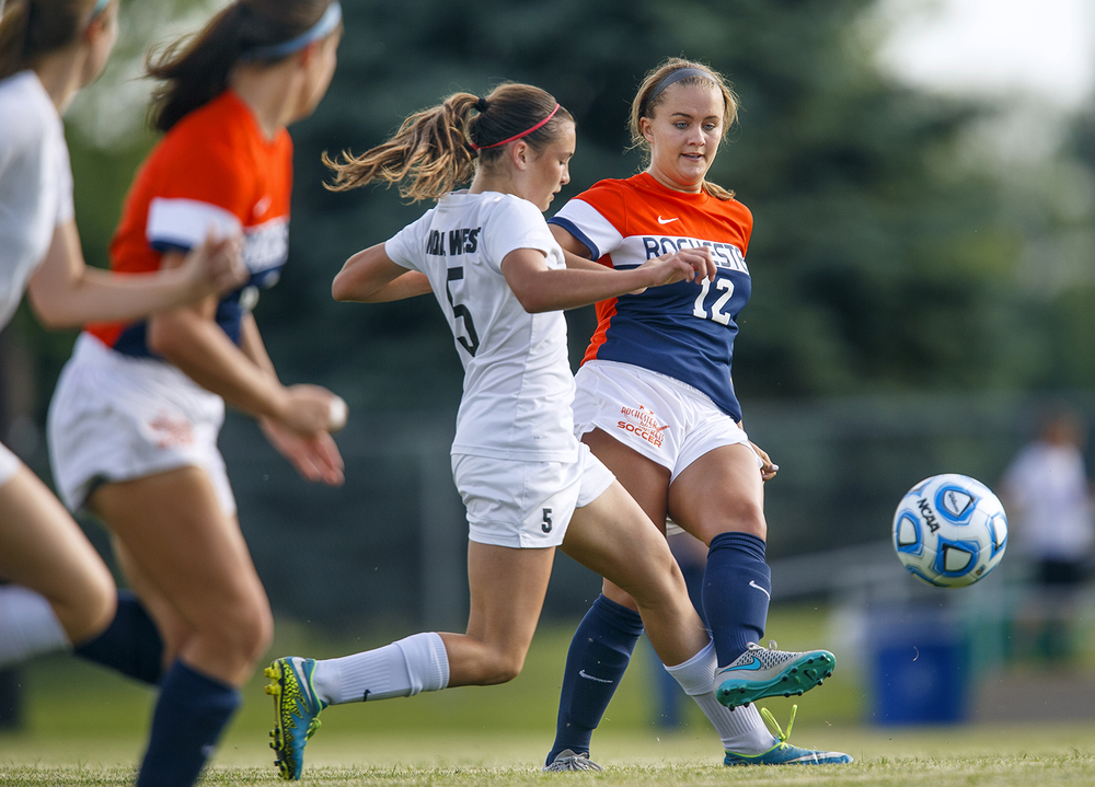 Rochester's Ally Milnes moves the ball upfield in front of a Normal West defender during the Class 2A Springfield Supersectional soccer at the University of Illinois Springfield Monday, May 31, 2016. Ted Schurter/The State Journal-Register