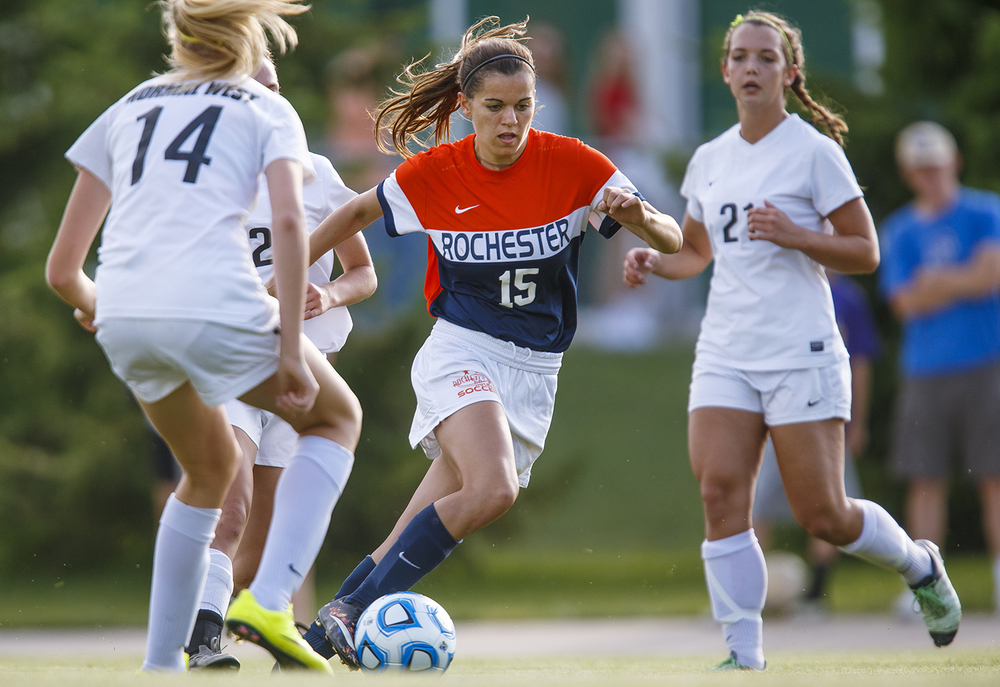 Rochester's Becca Jostes moves the ball past three Normal West defenders during the Class 2A Springfield Supersectional soccer at the University of Illinois Springfield Monday, May 31, 2016. Ted Schurter/The State Journal-Register