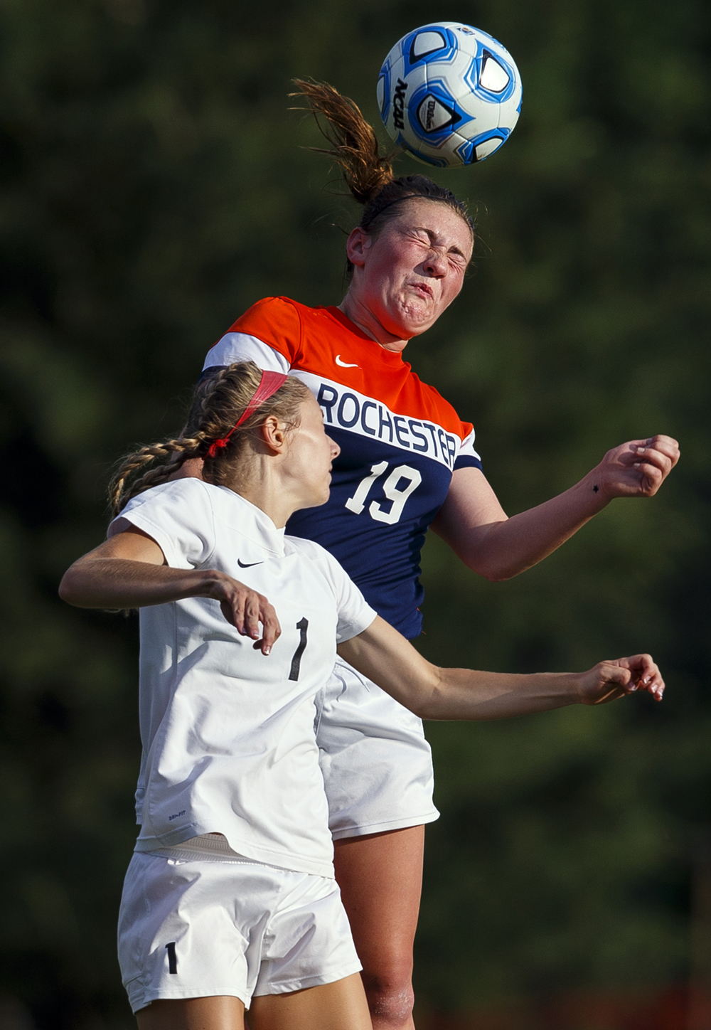 Rochester's Maddie Caps heads the ball in front of Normal West's Kate Lorenz during the Class 2A Springfield Supersectional soccer at the University of Illinois Springfield Monday, May 31, 2016. Ted Schurter/The State Journal-Register