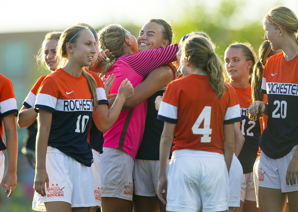 Rochester's Meagan McNicholas hugs keeper Maddie Gleeson after the Rockets defeated Normal West during the Class 2A Springfield Supersectional soccer at the University of Illinois Springfield Monday, May 31, 2016. Ted Schurter/The State Journal-Register