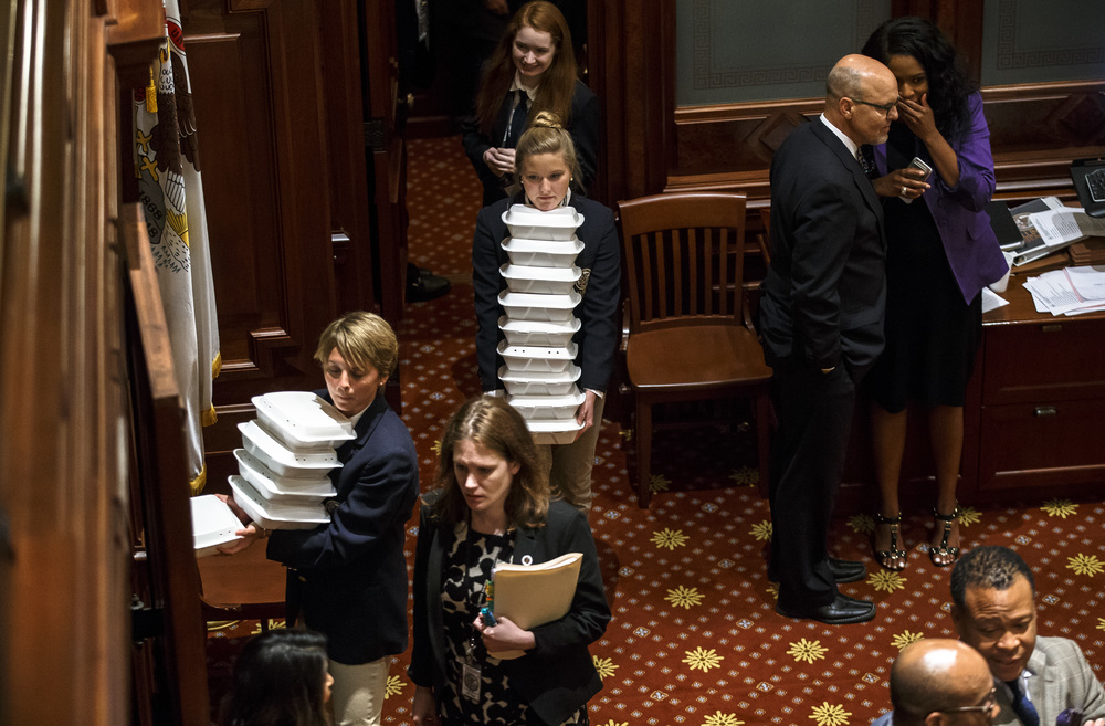 Boxes of food are brought into the Senate as debate goes late into the night on the final day of the spring legislative session at the Illinois State Capitol, Tuesday, May 31, 2016, in Springfield, Ill. Justin L. Fowler/The State Journal-Register