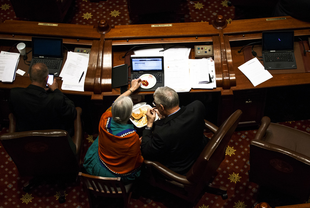 Illinois State Sen. Bill Haine, D-Alton, grabs a bite to eat on the Senate floor as debate goes late into the night on the final day of the spring legislative session at the Illinois State Capitol, Tuesday, May 31, 2016, in Springfield, Ill. Justin L. Fowler/The State Journal-Register