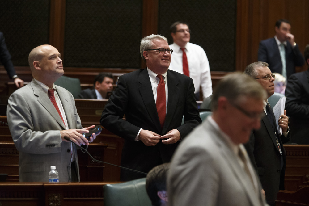 Illinois House Minority Leader Jim Durkin, R-Western Springs, center, reacts to the vote board as HB 2990 fails in the House 24-92 twenty minutes before the midnight deadline on the final day of the spring legislative session at the Illinois State Capitol, Tuesday, May 31, 2016, in Springfield, Ill. Justin L. Fowler/The State Journal-Register
