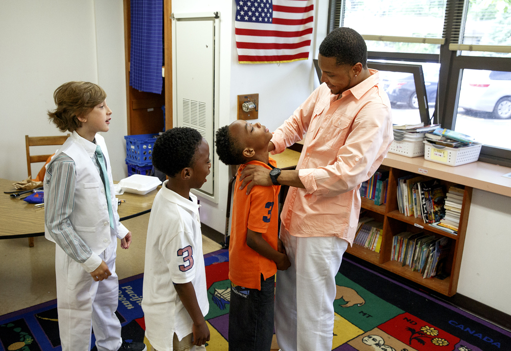 Joshawa Carrigan, left, Alijah Hill and his twin brother, Zachary, line up to say goodbye to Christian Mahone, a teacher in the fifth grade classroom at Jane Addams Elementary School Wednesday, June 1, 2016. It was the last day of school for Springfield School District 186 and Jane Addams held a graduation event for the fifth graders, who will go on to middle school next year. Rich Saal/The State Journal-Register