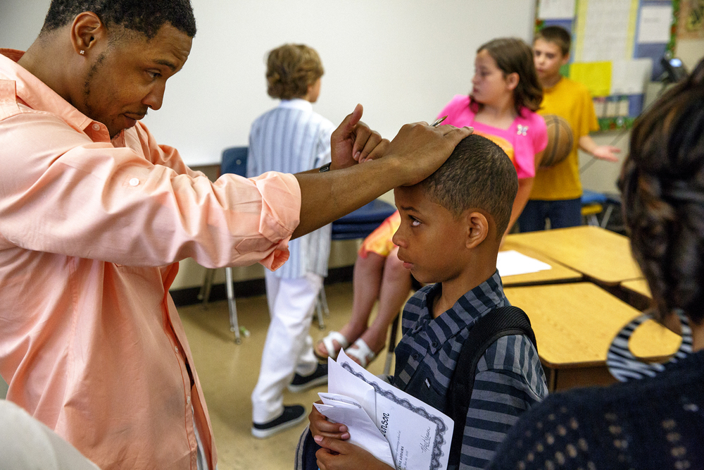 Christian Mahone offers his best words of encouragement to a tentative Khalil Stinson, one of his fifth-grade students, on the last day of classes at Jane Addams Elementary School Wednesday, June 1, 2016. The school held a graduation event for the class, who will go on to middle school next year. It was the last day of school for Springfield School District 186. Rich Saal/The State Journal-Register Find a gallery from the event at Visuals.SJ-R.com.