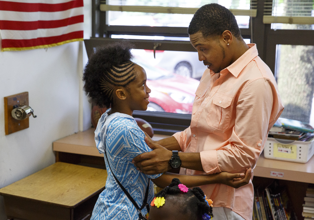 Shatavia Kidd says goodbye to her fifth grade teacher, Christian Mahone, on the last day of classes at Jane Addams Elementary School Wednesday, June 1, 2016. The school held a graduation event for the students, who will go on to middle school next year. It was the last day of school for Springfield School District 186. Rich Saal/The State Journal-Register
