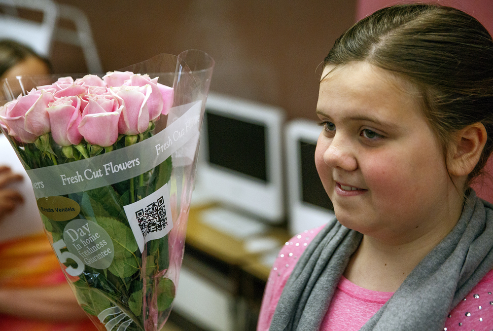 Grace Taylor, a fifth grader at Jane Addams Elementary School, holds roses given to her by her mother on the last day of classes Wednesday, June 1, 2016. The school held a graduation event for the students, who will go on to middle school next year. It was the last day of school for Springfield School District 186. Rich Saal/The State Journal-Register