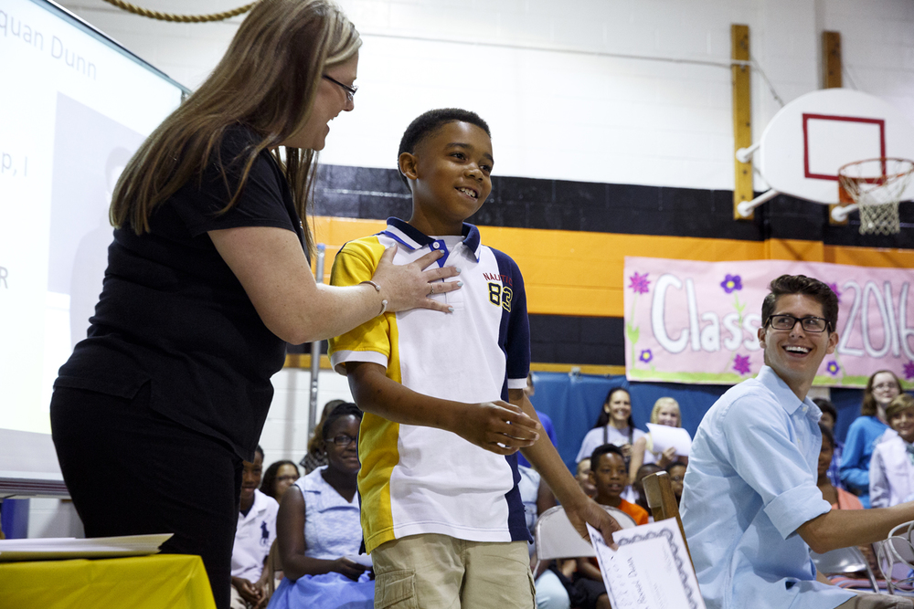 Jane Addams Elementary School principal Jennifer Hanson coaxes a smile from Daquan Dunn during a graduation event for the fifth grade class Wednesday, June 1, 2016. The school held a ceremony to say goodbye to the students, who will go on to middle school next year. It was the last day of school for Springfield School District 186. Rich Saal/The State Journal-Register
