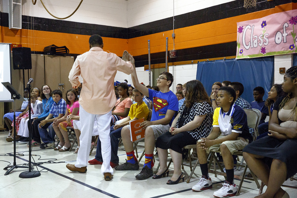 Christian Mahone, fifth grade teacher at Jane Addams Elementary School, high-fives Maximillian Crouch during a graduation event on the last day of classes Wednesday, June 1, 2016. The school held a ceremony to say goodbye to the students, who will go on to middle school next year. It was the last day of school for Springfield School District 186. Rich Saal/The State Journal-Register