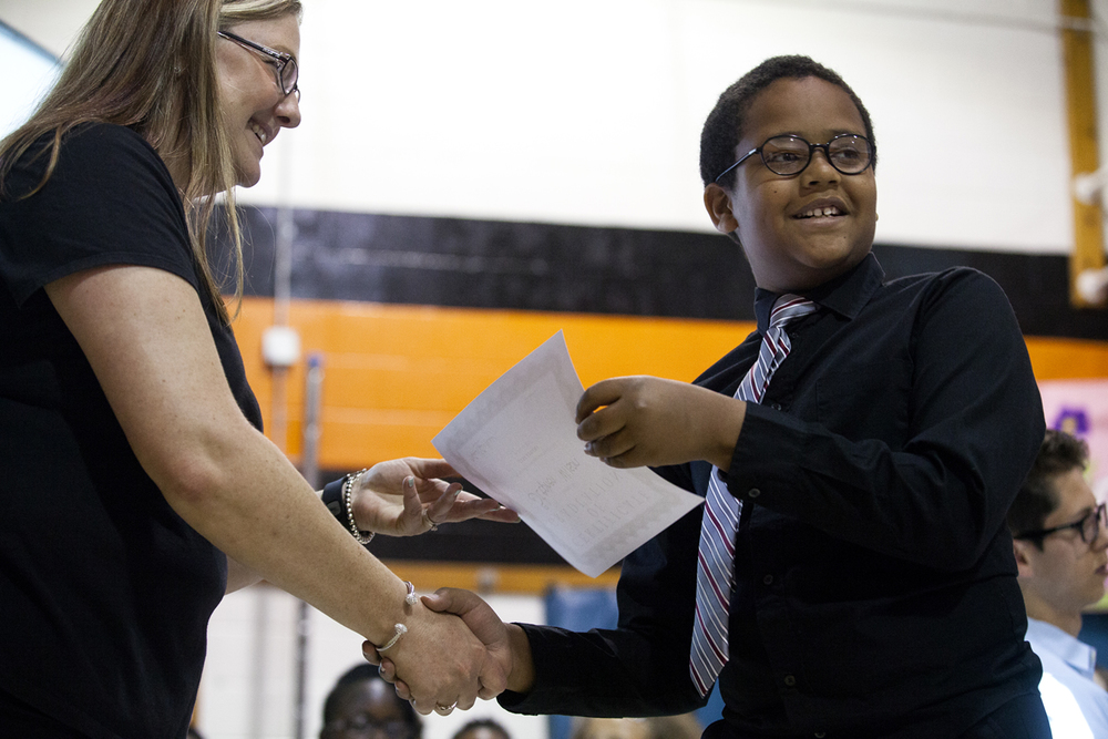 Stephen Wilson turns for a picture while he is presented with a certificate from Jane Addams Elementary School principal Jennifer Hanson Wednesday, June 1, 2016. The school held a graduation event for its fifth grade students, who will go on to middle school next year. It was the last day of school for Springfield School District 186. Rich Saal/The State Journal-Register