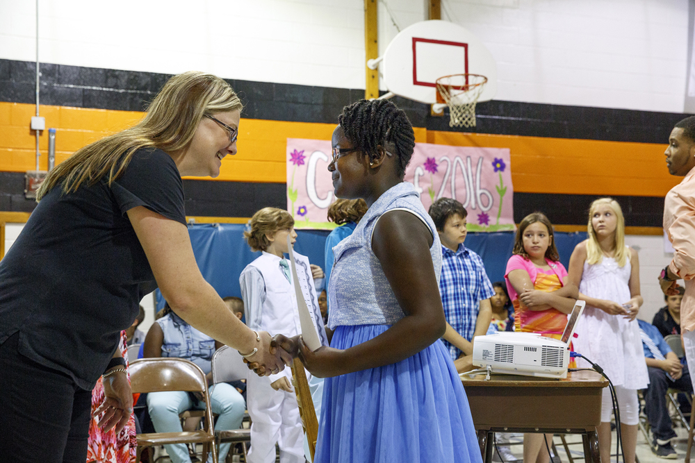 Jane Addams Elementary School principal Jennifer Hanson present Victoria Alamu with a certificate on the last day of classes Wednesday, June 1, 2016. The school held a graduation event for the fifth grade students, who will go on to middle school next year. It was the last day of school for Springfield School District 186. Rich Saal/The State Journal-Register