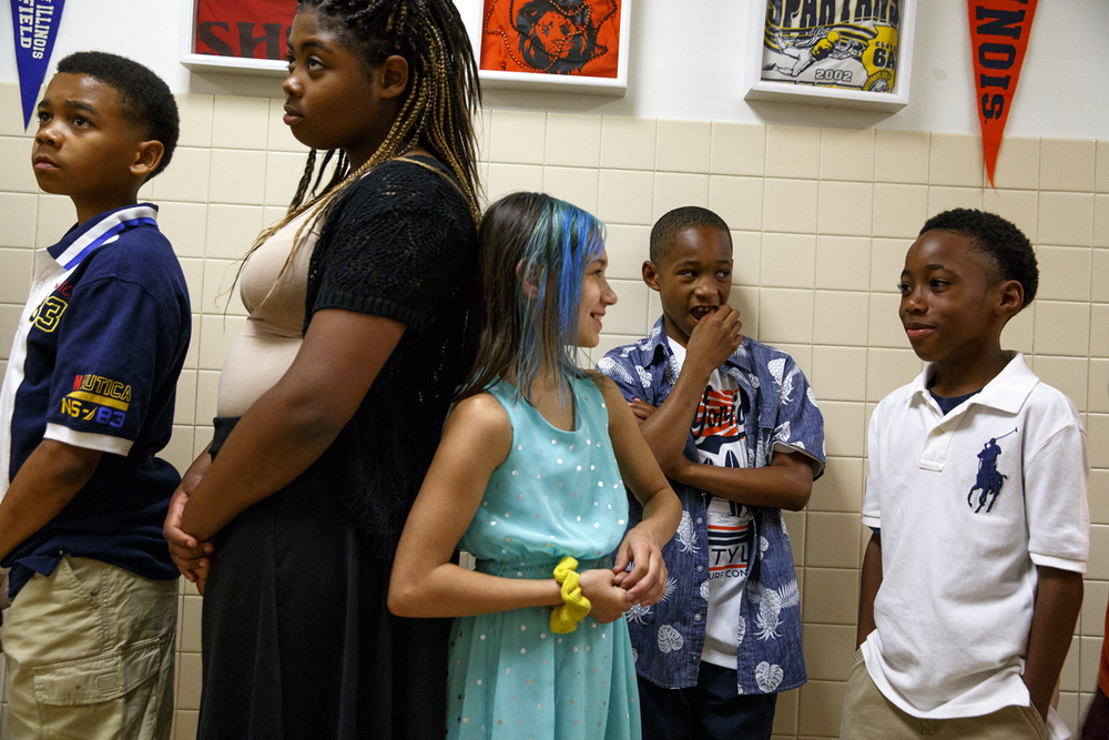 Daquan Dunn, left, Quiera Edwards, Imala Farris, Antwan Hamilton and Alijah Hill line up in the hall for a graduation event on the last day of classes at Jane Addams Elementary School Wednesday, June 1, 2016. The school held the ceremony for the students, who will go on to middle school next year. It was the last day of school for Springfield School District 186. Rich Saal/The State Journal-Register