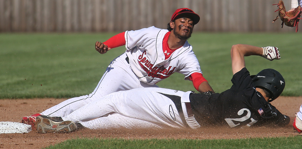 In second inning action, Springfield second baseman Vishakh Patel was late with the tag as Champaign Central baserunner Jake Beesley slides safely into the second. David Spencer/The State Journal-Register