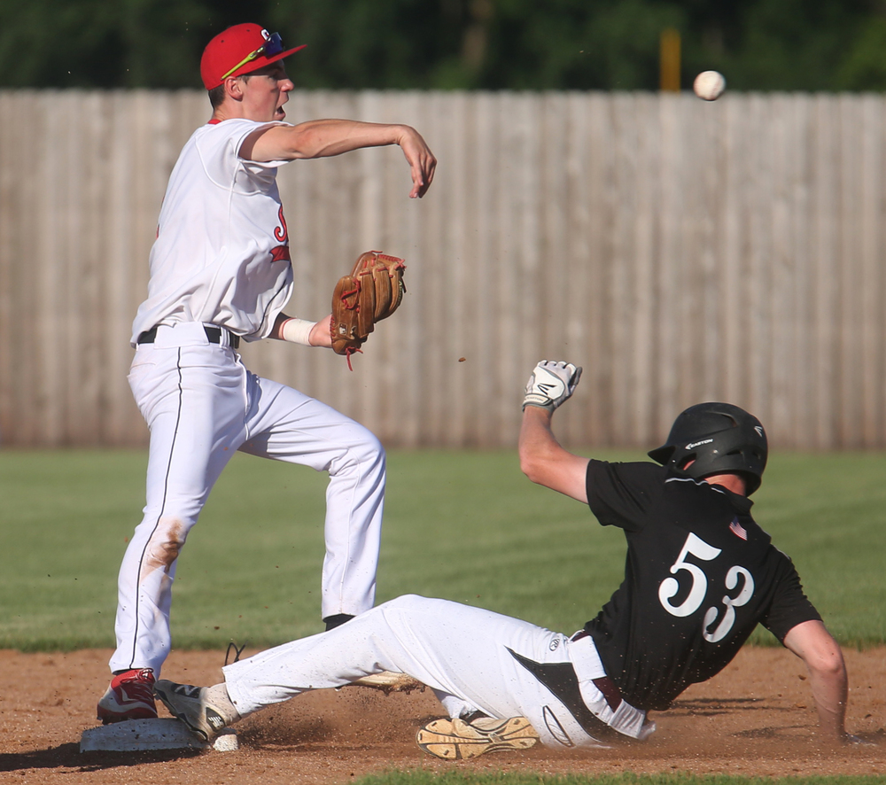 In sixth inning action, Springfield shortstop Trevor Minder goes for the double play after sliding Champaign Central runner Tanner Gordon is out. David Spencer/The State Journal-Register