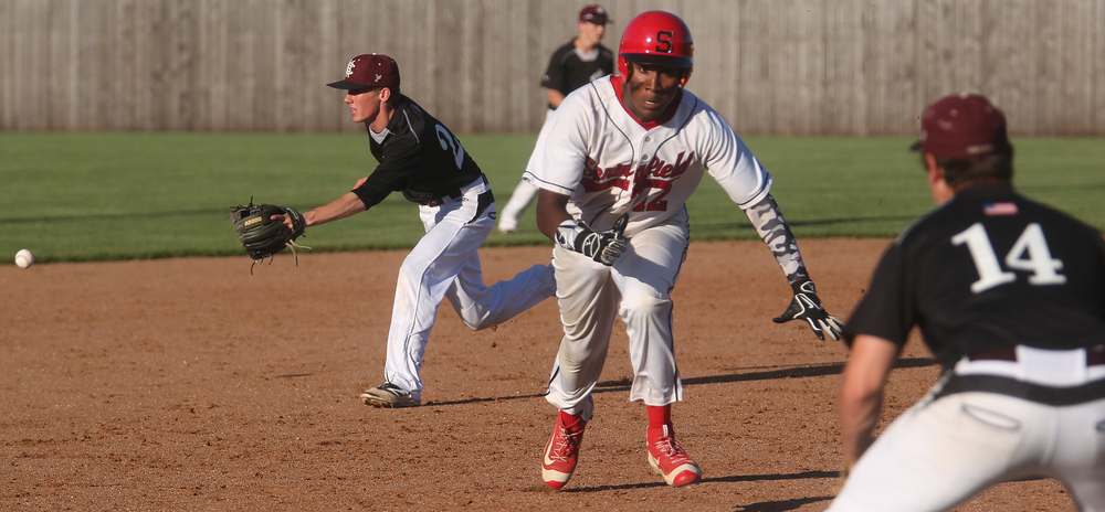 In seventh inning action, Springfield baserunner Damian Pierce prepares to slide safely into third base. David Spencer/The State Journal-Register